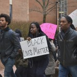 Towson University students and faculty participated in a march from Freedom Square to Cook Library on December 12. Abby Murphy/ The Towerlight