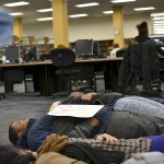 "Towson University students and faculty participated in a ""die in"" protest at Cook Library on Dec. 12. Abby Murphy/ The Towerlight"