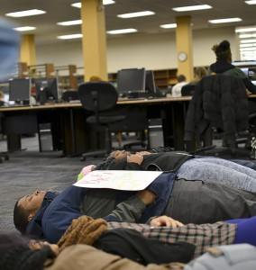 """Towson University students and faculty participated in a """"die in"""" protest at Cook Library on Dec. 12. Abby Murphy/ The Towerlight"""