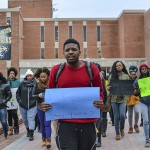 Towson University students and faculty participated in a march from Cook Library to Susquehanna Terrace on Dec. 12. Abby Murphy/ The Towerlight