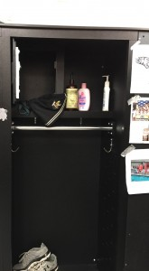 Members of the swim team say that the phone was placed behind the hat in this locker, and that they first noticed the phone because of the light it reflected off the black back of the locker.
