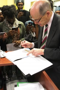 Interim President Timothy Chandler signing the document and list of demands.