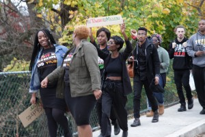 Students marching through campus to the Administration Building.