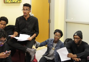 Student Activists John Gillespie (center left) and Bilphena Yahwon (center right) lead a discussion about the students' demands.