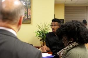Student activist John Gillespie speaking to administrators.