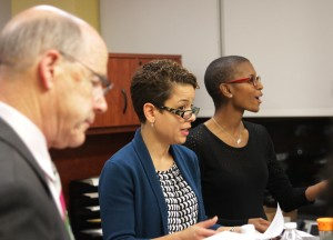 Interim President Timothy Chandler (left), General Counsel Traevena Byrd (center) and Deputy Chief of Staff Marina Cooper (right) address students.