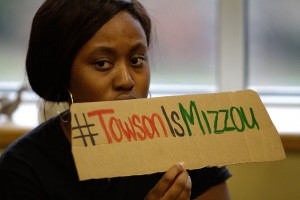A student holds a sign at the sit-in protest on 11/18/15.