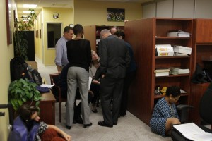 Members of the administration step away from students to discuss plans for the night.