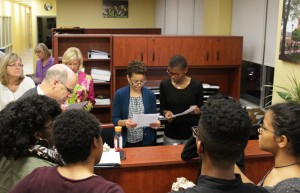 Administrators look over a revised listed of demands from students.