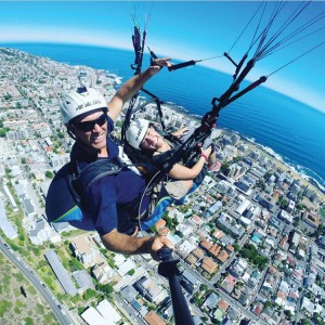 Courtesy of Christina Mattera Christina Mattera and her guide paraglide from a mountain in her latest South African adventure.