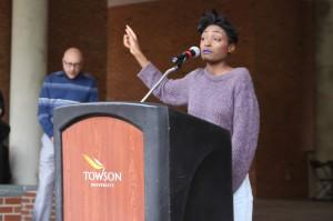 Breya Johnson speaks at the rally.