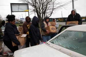 Towson students and other volunteers load food and water into a car in Flint, Michigan. Cody Boteler/The Towerlight