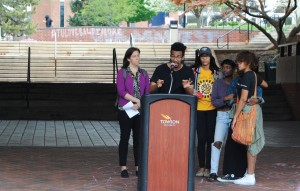 Student activist John Gillespie addresses the rally, supported by other students and faculty.