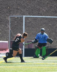 Katie McNeel fires a shot against Ohio goalkeeper Lina Trucco Sunday at Johnny Unitas Stadium.