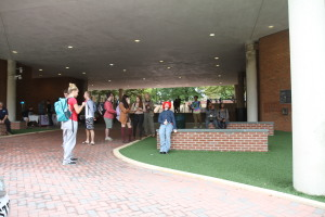 Students congregate around the art project. Photo by Cody Boteler