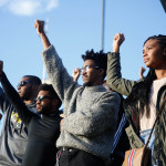 """Towson students sing """"Lift Every Voice and Sing."""" Photo by Joe Noyes."""