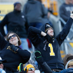 Fans cheer during the football game. Photo by Joe Noyes.