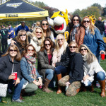 Doc the Tiger poses with a group during the tailgate. Photo by Joe Noyes.