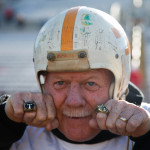 A Towson alumni wearing two Towson rings and a vintage Towson State football helmet. Photo by Joe Noyes.