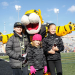 Doc the tiger poses with kids at the game. Photo by Joe Noyes.