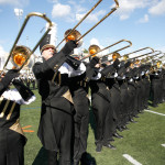 The marching band performs during the half-time show. Photo by Joe Noyes.