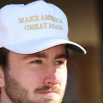 "A man in a ""Make America Great Again"" hat at a pro-Trump rally on campus. Photo by Cody Boteler."