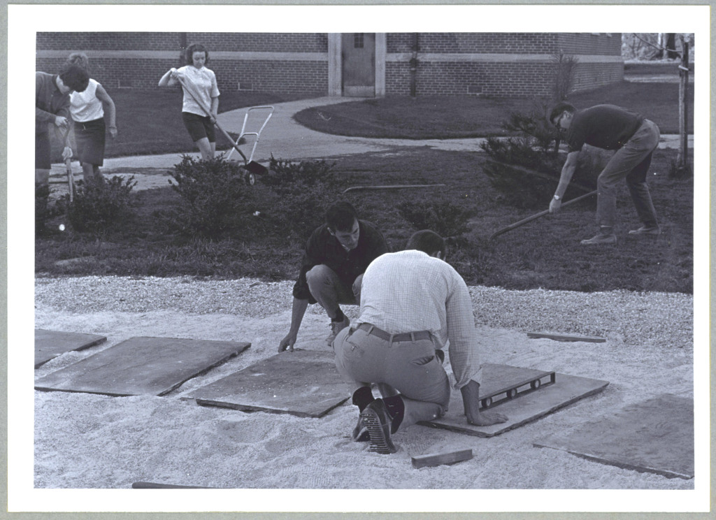 Students from the Class of 1967 build a rock garden outside Prettyman and Scarborough halls. Courtesy of TU's Cook Library Digital Archives.