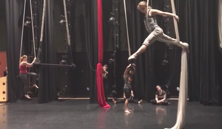 Students practice for their finals in Jayne Bernasconi's aerial dance class.