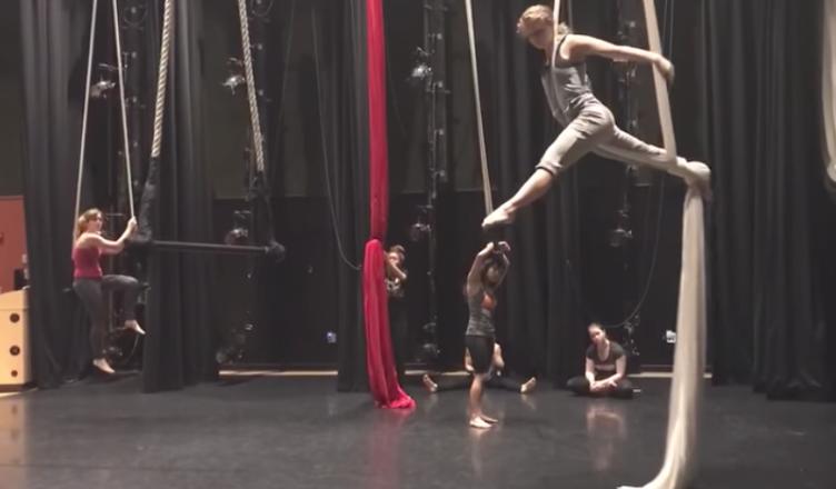 Students practice for their finals in Jayne Bernasconi's aerial dance class.